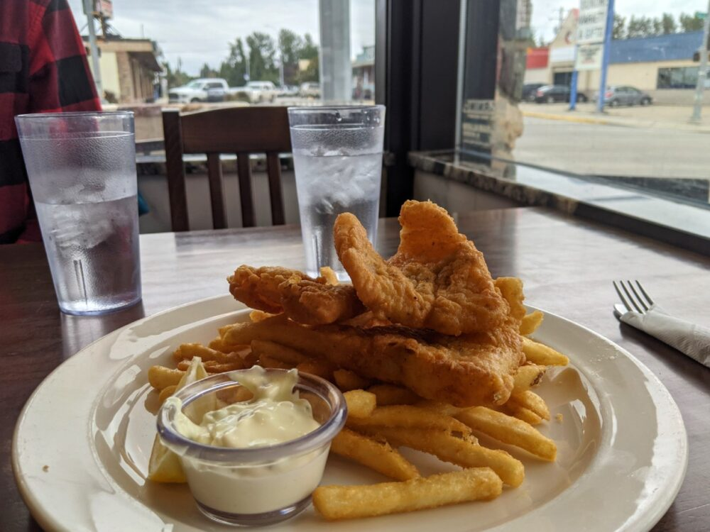 Close up of fish and chips dish at Sundre Hotel, with windows visible in background