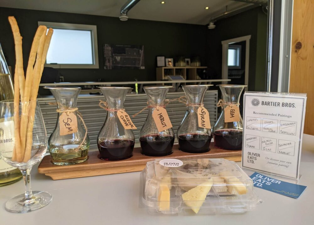 Close up of wine tasting flight with package of cheese at Bartier Bros.