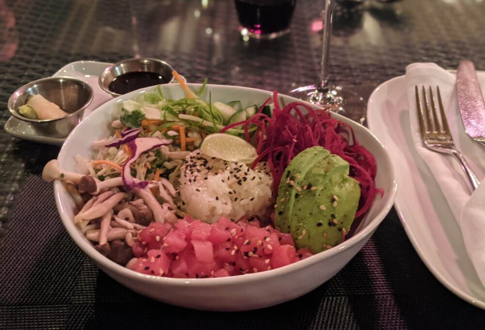 Front on view of poke bowl at 15 Park Bistro, with pickled ginger, avocado, rice, cabbage and tuna