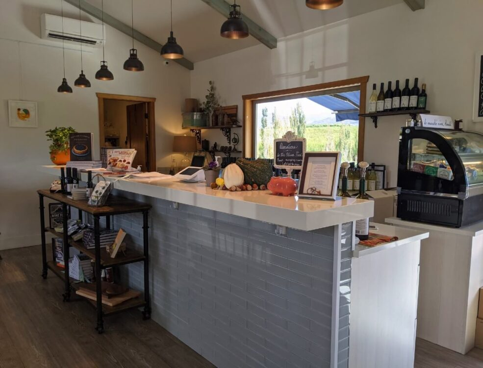 Modern tasting bar with cheese deli cabinet, inside VinAmité Wine Lounge